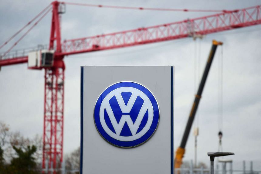 The logo of German car maker Volkswagen near cranes of a construction site in Wolfsburg, on Nov 9, 2015.