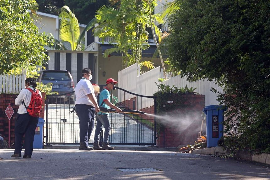 NEA officers and contractors carrying out misting and inspection, and issuing notices to residents at Watten Estate on May 15, 2016.