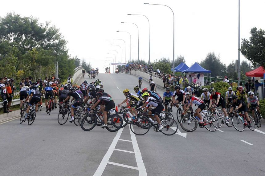 Participants of the Men's Open event at the inaugural OCBC Cycle Road Race at Seletar, on March 13, 2016.
