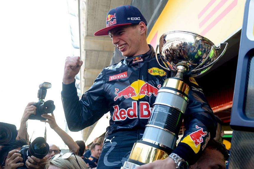 Max Verstappen celebrates winning with his team after the Spanish Formula One Grand Prix on May 15, 2016.