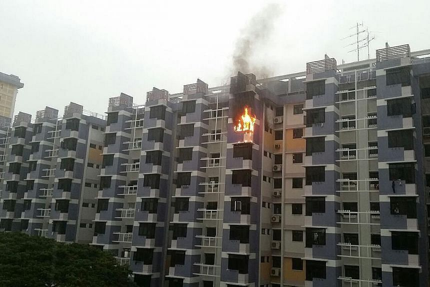 The fire broke out on the 12th floor of Block 117, Bedok North Road (left). Mr Salleh (below), an SCDF staff sergeant who lives next to the affected unit, was alerted by the cries for help from the home owner's daughter.