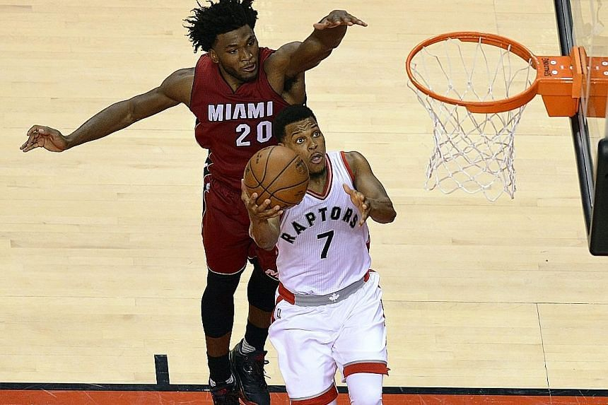 Miami's Justise Winslow tries to defend against Toronto's Kyle Lowry during the fourth quarter in their Eastern Conference semi-final play-off. The Raptors won the decisive seventh game 116-89 to win the series and advance to the final where they wil