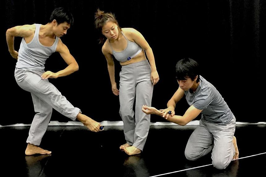 Dancers (above from left) Matthew Goh, Melyn Chow and Kong Wei Jie.