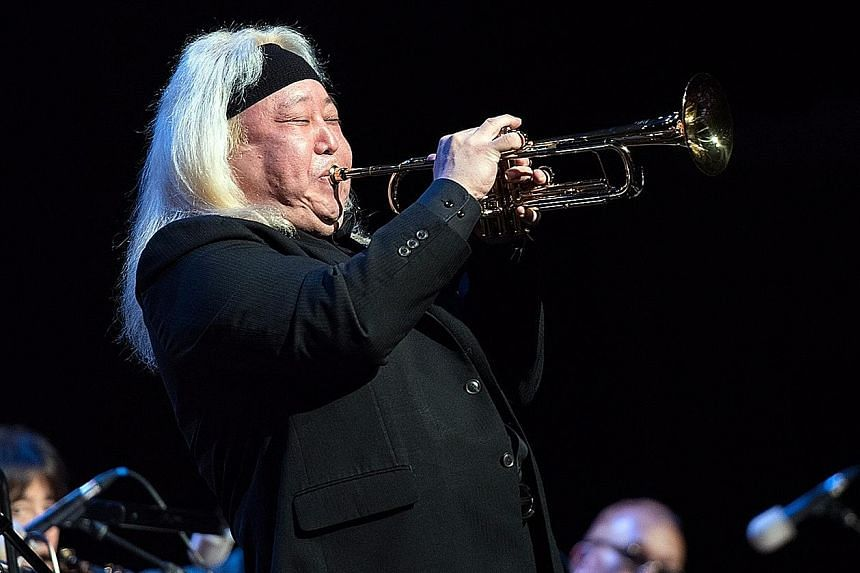 The Sammo Hung-like Trumpeterconductor Eric Miyashiro (above) on his trumpet.