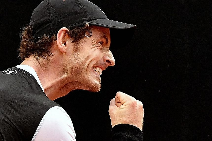 Andy Murray celebrates his win against Novak Djokovic during the final of the Rome Masters at the Foro Italico. The Scot defeated the world No. 1 6-3, 6-3.