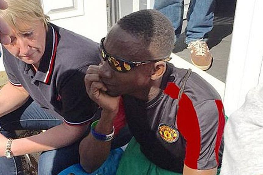 Manchester United fans (above) were left disappointed after Sunday's game against Bournemouth was called off. One fan, Moses (left) from Sierra Leone, was reduced to tears. His anguish moved the Manchester United Supporters Trust to raise funds for h