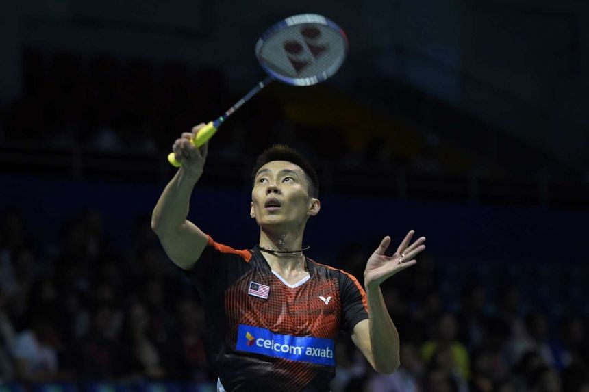 Lee Chong Wei of Malaysia hits a return to Kai Schaefer of Germany during their men's singles group match in the Thomas Cup badminton tournament in Kunshan, eastern China's Jiangsu Province on May 16.
