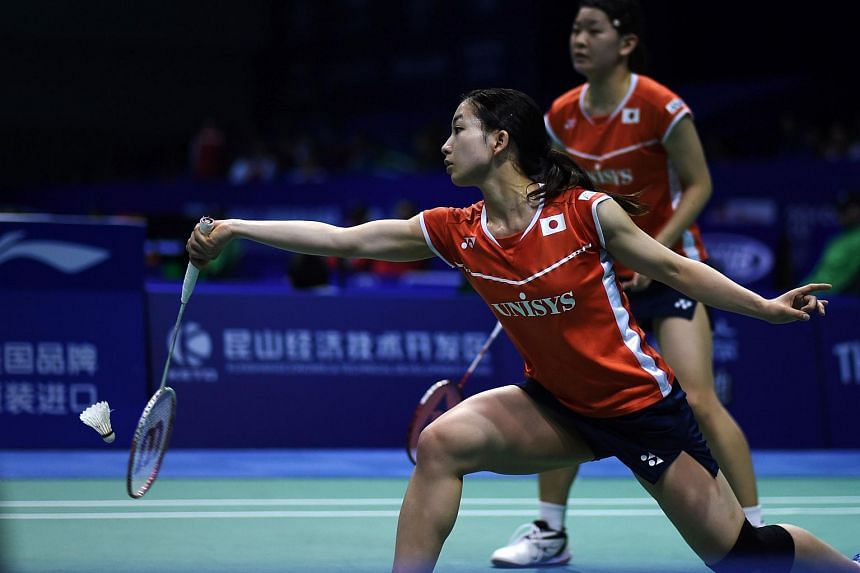 Misaki Matsutomo (front) and Ayaka Takahashi of Japan return a shot against Isabel Herttrich and Lara Kaepplein of Germany during their doubles match in the Uber Cup badminton tournament in Kunshan, eastern China's Jiangsu Province on May 16, 2016.