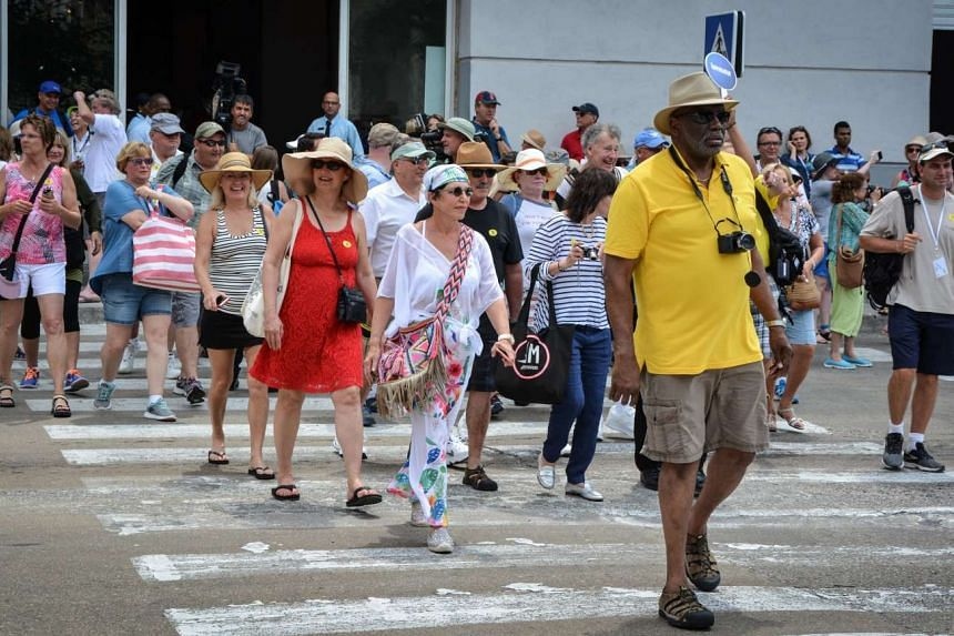 Passengers of the first US-to-Cuba cruise ship to arrive in the island nation in decades, walking in the streets of Havana right after disembarking on May 2, 2016.