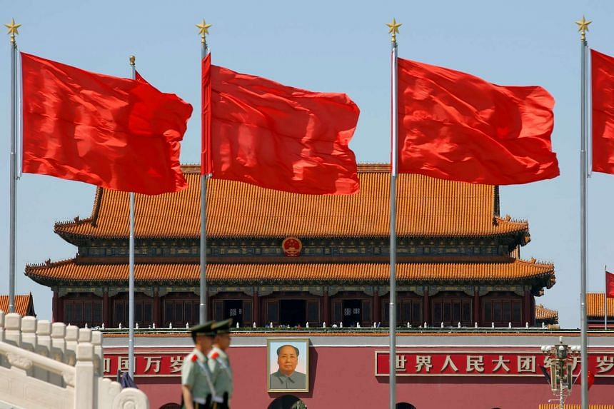 Paramilitary solders standing guard at Tiananmen Square where the portrait of late Chinese chairman Mao Zedong is seen, on the 50th anniversary of the start of the Cultural Revolution in Beijing, China, on May 16, 2016.