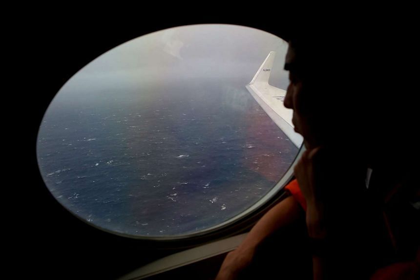 A Japan Coast Guard member keeping watch for debris from Malaysia Airlines flight MH370 on April 1, 2014.
