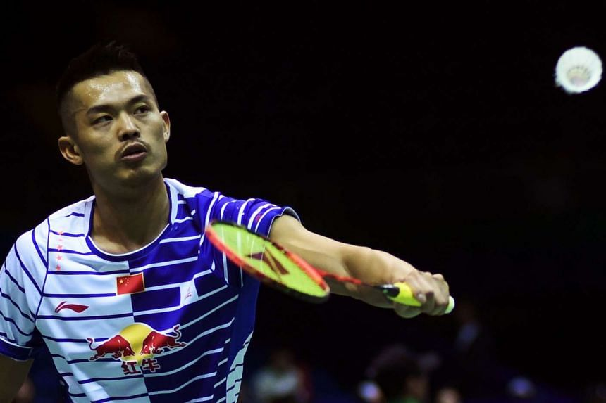 Lin Dan hits a return against Lucas Claerbout in their men's singles group match in the Thomas Cup in Kunshan, on May 16, 2016.