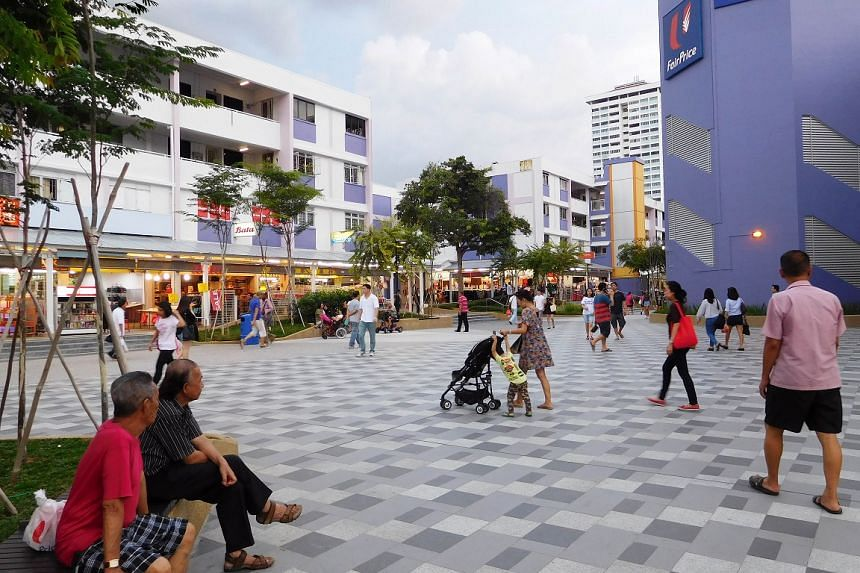 (After) Floor finishes at the pedestrian mall have been enhanced to offer better walking and shopping experience. There are also more seats and landscaping.