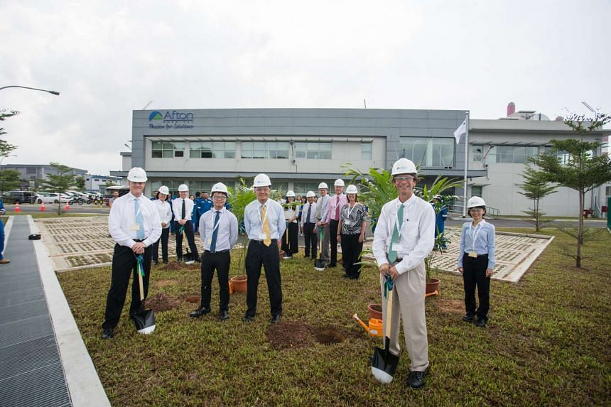 Afton Chemical Corporation staff and Economic Development Board (EDB) representatives at the newly-built lubricant additive manufacturing plant on Jurong Island.