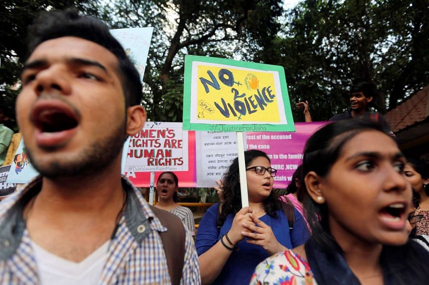 Demonstrators shout slogans during a protest against the rape and murder of a law student in Kerala, India, on May 11, 2016.