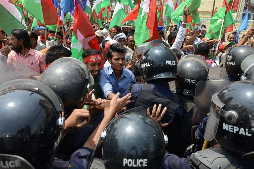 Nepalese activists from the Federal Alliance scuffle with police during a demonstration against the government in Kathmandu, on May 17, 2016.