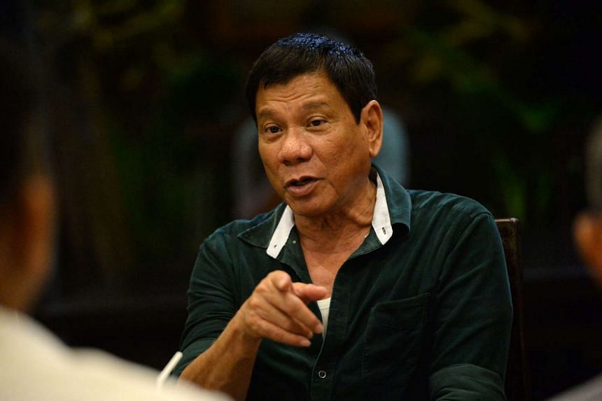 Philippines' president-elect Rodrigo Duterte speaks to military and police officials at a hotel in Davao City, on May 15, 2016.