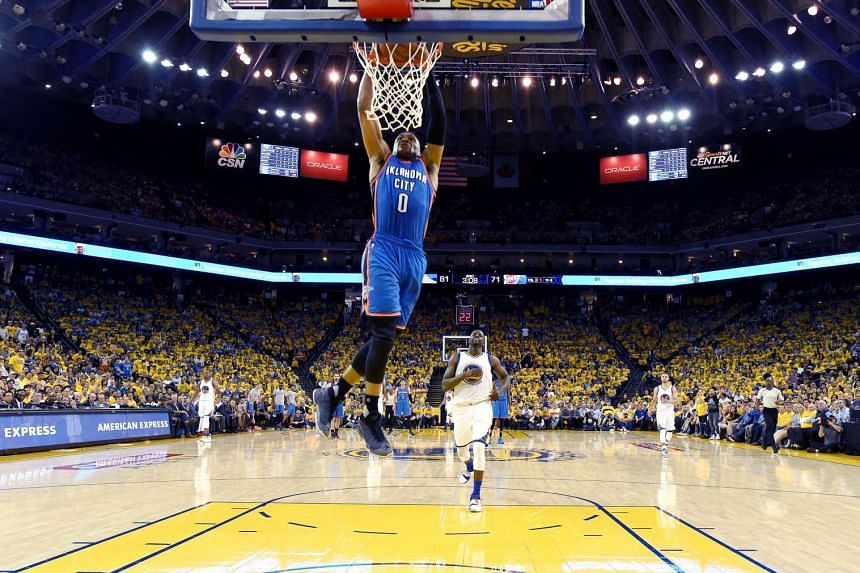 Russell Westbrook of the Oklahoma City Thunder dunks the ball in Game 1 of the NBA Western Conference Final, on May 16, 2016.