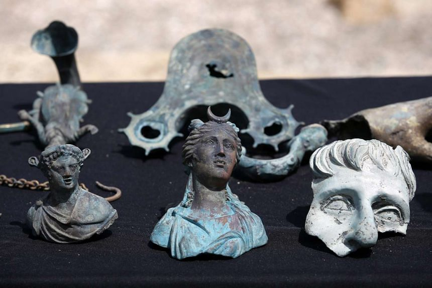 Israeli divers found an ancient marine cargo in a merchant shipwreck that sank during the Late Roman period 1,600 years ago at the Caesarea National Park seabed. Hundreds of coins and statues from the Roman period were discovered.
