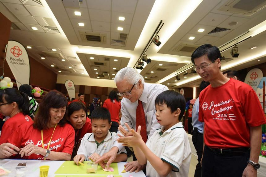 President Tony Tan Keng Yam interacting with children from Rainbow Centre, a beneficiary under the President's Challenge at the launch of PA's President's Challenge 2016 on May 17, 2016.