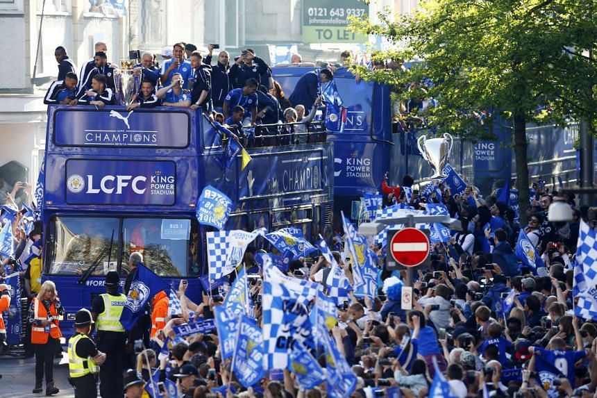 Premier League title winners Leicester City enjoy an open-top bus parade as the city celebrates the club being named English champions for the first time in its 132-year history.