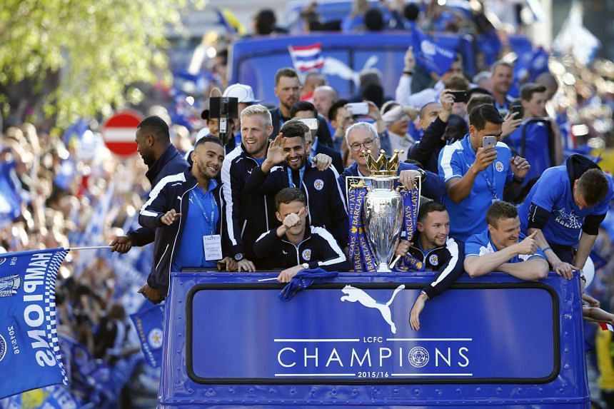 The club's players wave to crowds from an open-top bus that paraded through the city centre.