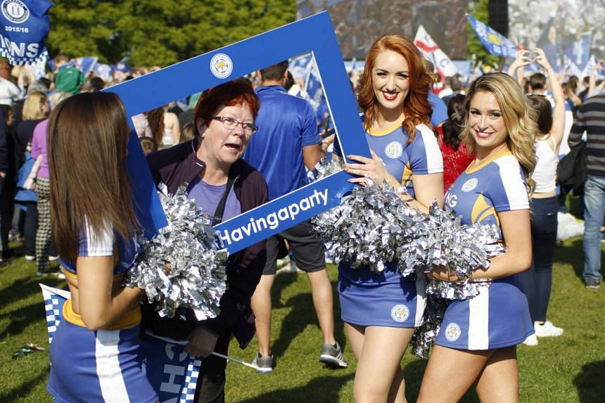 Cheerleaders decked in the signature blue of Leicester City at the trophy parade.