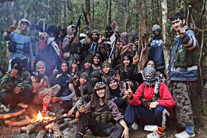 Members of the East Indonesia Mujahidin (MIT) terrorist group led by Indonesia's most-wanted man Santoso, whose real name is Abu Wardah, took a picture at their hiding place in the forests of Poso in Central Sulawesi.