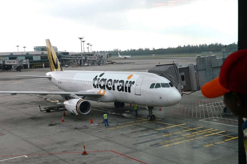 A Tigerair plane at Changi Airport. Eight Asian budget carriers, including Scoot and Tigerair, have joined hands to launch the world's biggest low-cost carrier alliance.
