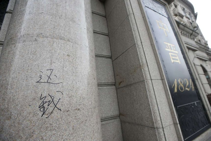"""The Chinese words """"return the money"""" is seen scribbled outside their office in Shanghai, China, on April 7, 2016."""