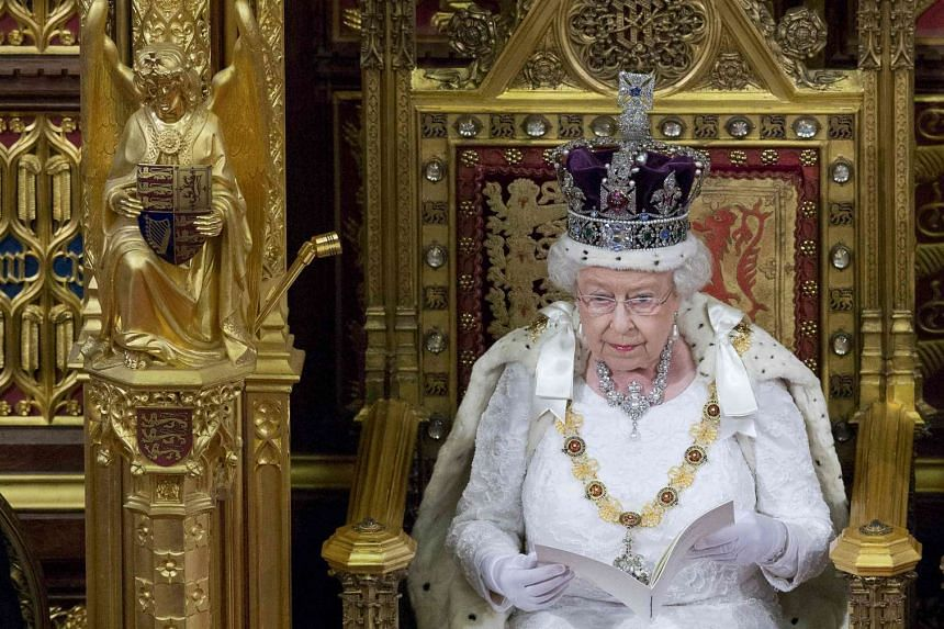 Britain's Queen Elizabeth II delivers the Queen's Speech during the State Opening of Parliament in central London, on May 18, 2016.