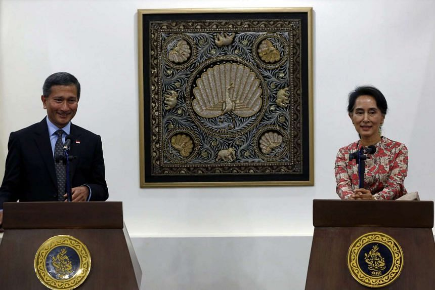 Myanmar Foreign Minister and State Counsellor Aung San Suu Kyi and Singapore's Foreign Minister Vivian Balakrishnan holding a joint press conference following their meeting at the Ministry of Foreign Affairs in Naypyitaw, Myanmar, on May 18, 2016.