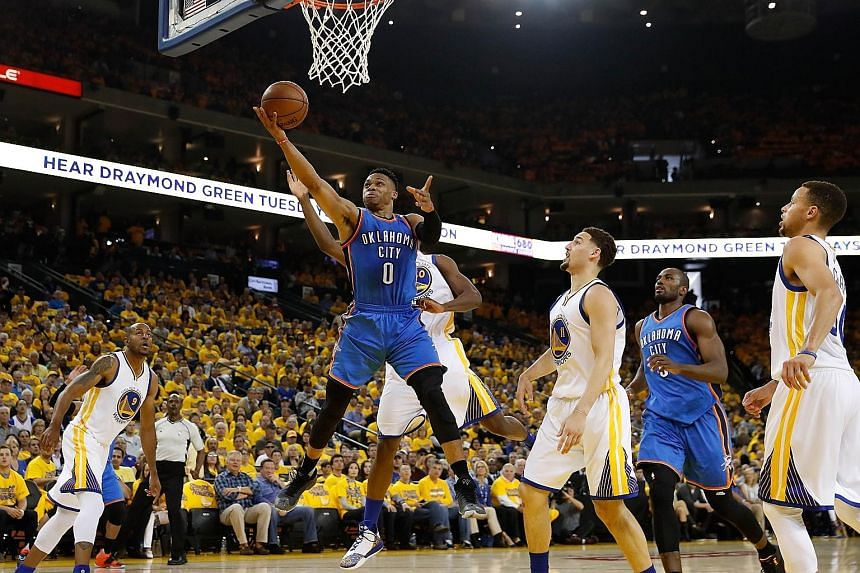 Thunder guard Russell Westbrook going up for a shot against the Golden State Warriors during Monday's game.