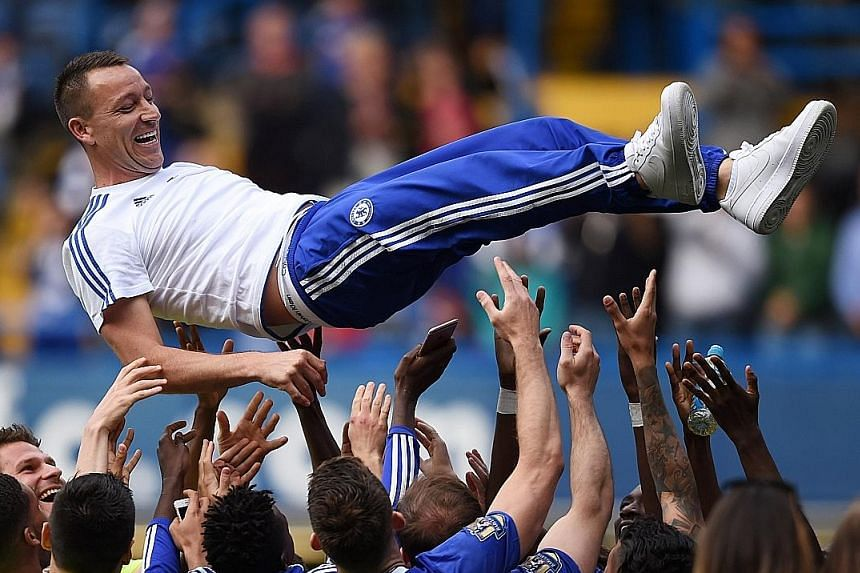 Chelsea defender John Terry, 35, is thrown by team-mates after the side's season-ender against Leicester City on Sunday. His future remains up in the air as he mulls over a one-year offer.