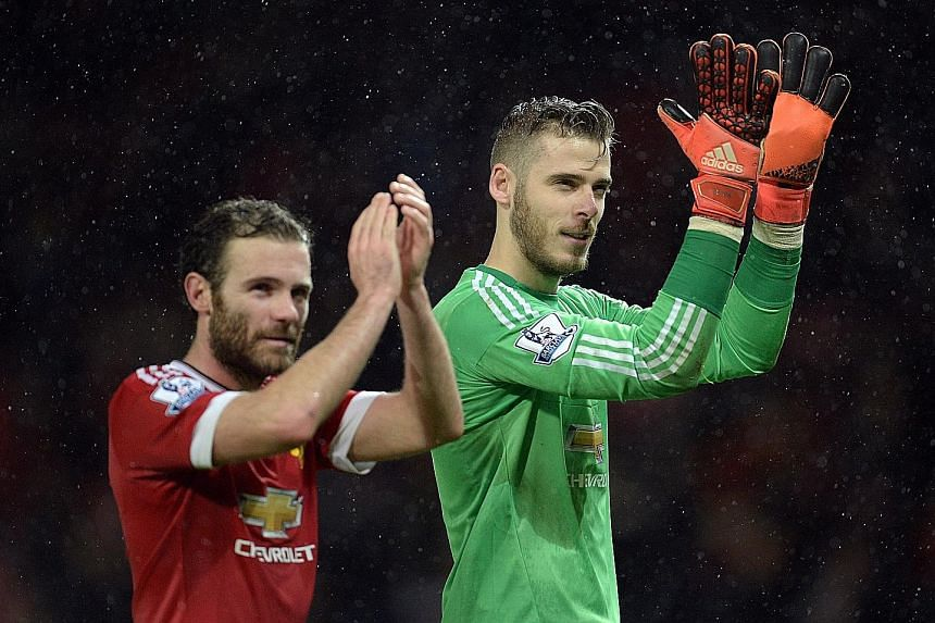 United's under-par season has seen Juan Mata (left) of Spain join France's Morgan Schneiderlin and England's Michael Carrick (England) as Euro 2016 absentees. But goalkeeper David de Gea (right) will be in France with the defending champions after an