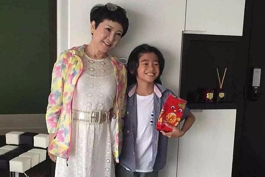 Cecilia Cheung's manager posted photos of Deborah Li visiting her grandsons Quintus (right) and Lucas after a Hong Kong producer complained that Cheung has denied her in-laws access to her sons.