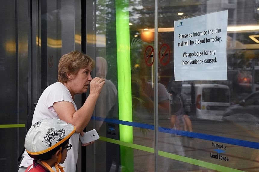 Although a notice at the main entrances indicated that the mall was closed, some bewildered shoppers were seen waving their hands in front of the automated glass doors, which would not open.