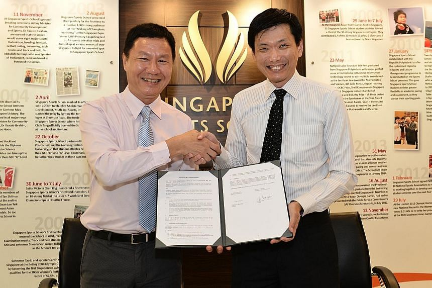 Singapore Sports School principal Tan Teck Hock (left) and Ngee Ann Polytechnic counterpart Clarence Ti at yesterday's memorandum of understanding signing.