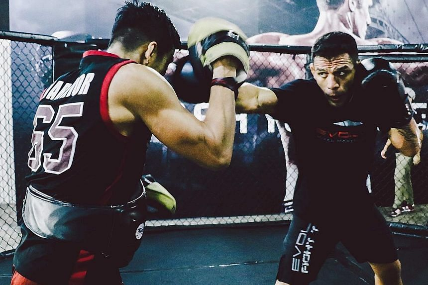 UFC lightweight champion Rafael dos Anjos (right) in training at Evolve MMA. The Brazilian will return to UFC action in July in a title bout with Eddie Alvarez.