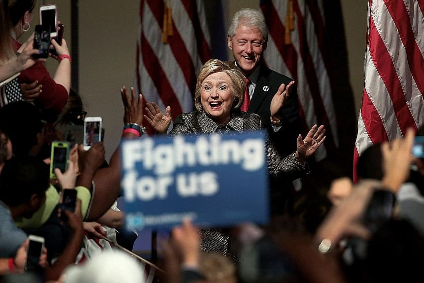 """Mrs Hillary Clinton says her husband, former president Bill Clinton, has """"got to come out of retirement and be in charge"""" of creating jobs. Mr Clinton oversaw a period of economic prosperity during his presidency."""