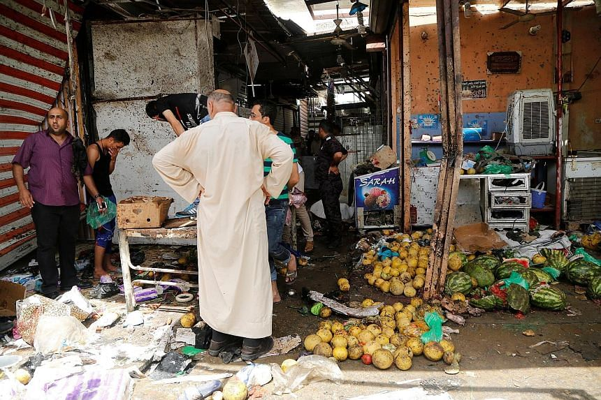 A suicide bombing claimed by ISIS in a marketplace in the mainly Shi'ite Muslim district of Shaab killed 38 people and left more than 70 people injured.