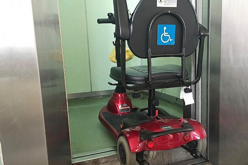 Mr Lim Hang Chiang's mobility device (far left) tipped as the floor of the lift was about 15cm higher than that of the lobby when the doors opened. (Left) A notice put up on the suspension of lift operation.