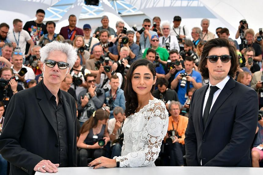 US director Jim Jarmusch, French-Iranian actress Golshifteh Farahani and US actor Adam Driver posing on May 16, 2016, during a photocall for the film Paterson at the 69th Cannes Film Festival.
