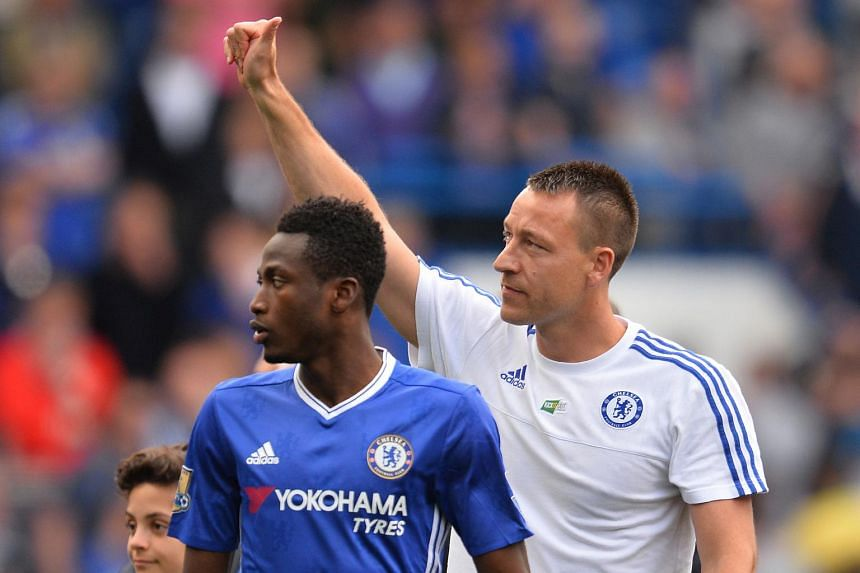Chelsea's English defender John Terry (right) giving a thumbs up after the English Premier League football match between Chelsea and Leicester City on May 15, 2016. Chelsea and Nike have agreed to the second-biggest apparel deal in English soccer.