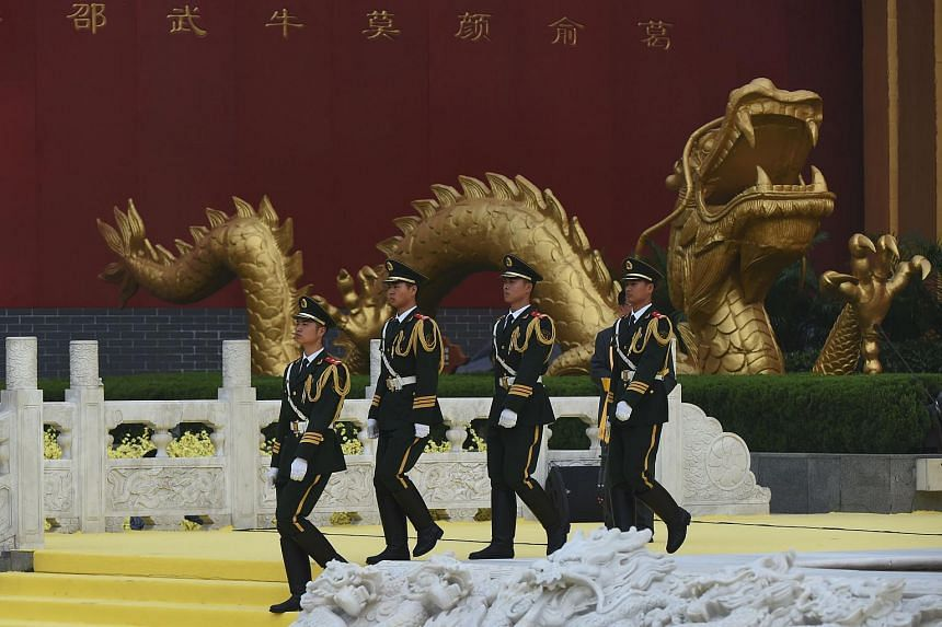 Paramilitary police marching during a memorial ceremony for the Yellow Emperor, or Huangdi, in Xinzheng, in China's Henan province on April 9, 2016.