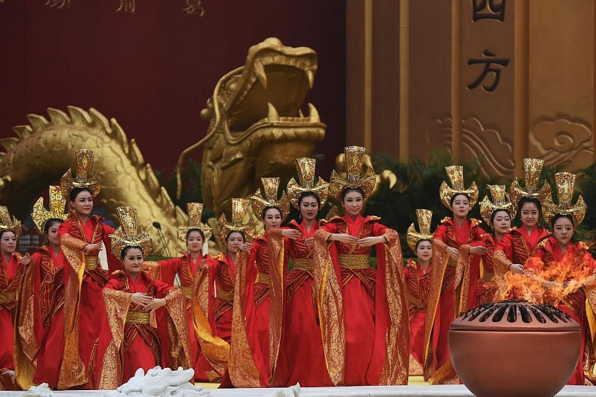 Dancers performing during a memorial ceremony for the Yellow Emperor, in Xinzheng, in China's Henan province on April 9, 2016.