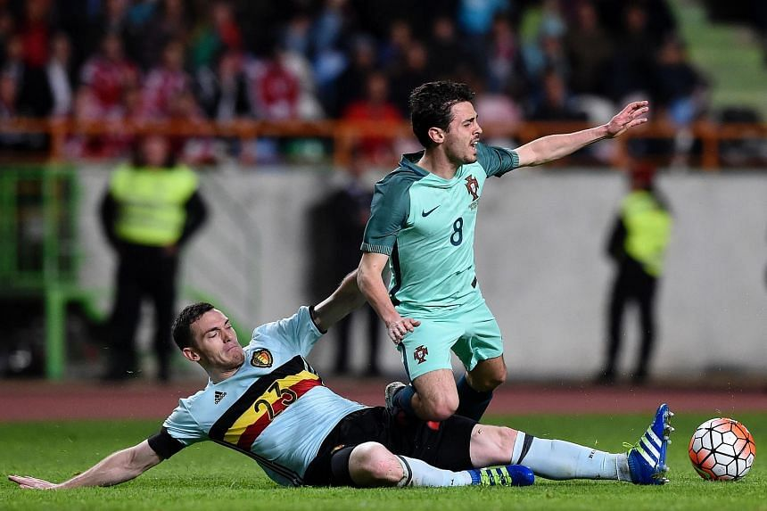 Belgium's defender Thomas Vermaelen (left) vies with Portugal's midfielder Bernardo Silva during the friendly football match between Portugal and Belgium.