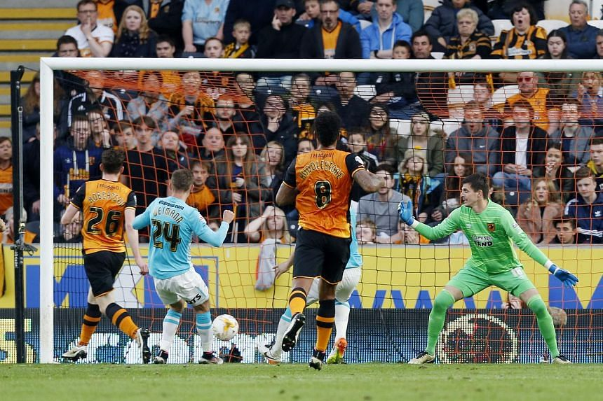 Hull City's Andrew Robertson scoring an own goal and the second goal for Derby County.