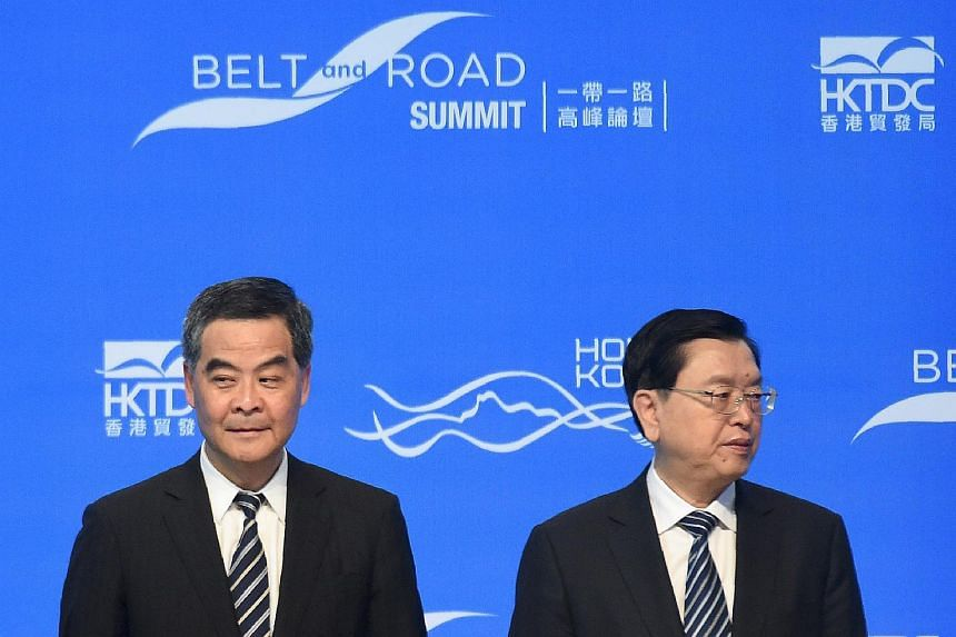 Hong Kong Chief Executive Leung Chun-ying (left) and Zhang Dejiang (right), who chairs China's communist-controlled legislature, waiting on stage before the opening of the Belt and Road Summit in Hong Kong on May 18, 2016.