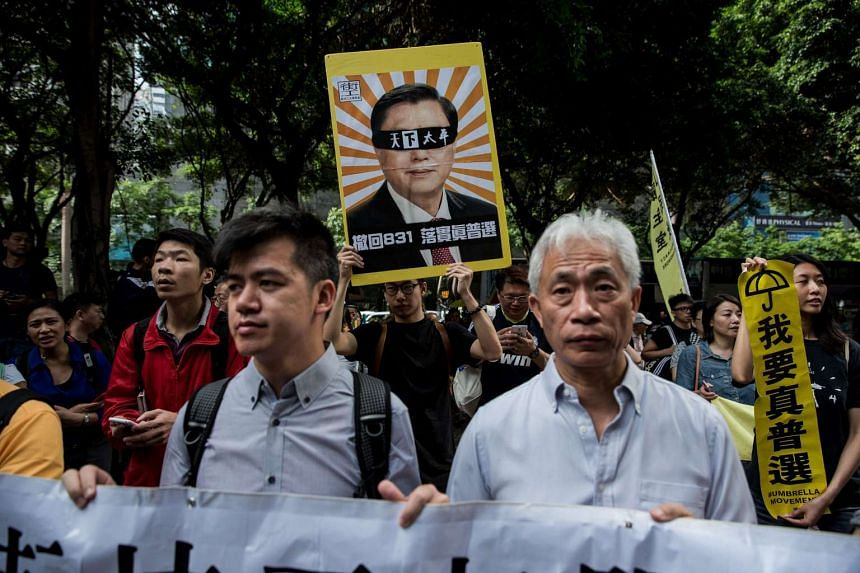 Zhang Dejiang is featured on a placard during a pro-democracy protest in Hong Kong on May 18, 2016.